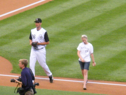 Jeff with girl who threw the first pitch.JPG