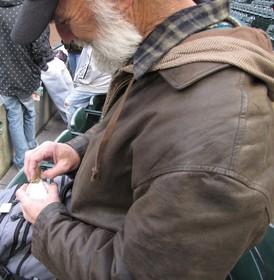 Robert sanding a baseball 4-27-09.jpg