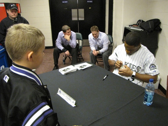 Eric Young Jr signing Hunters ball.jpg