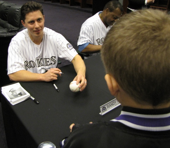 Flores signing Hunters ball.jpg