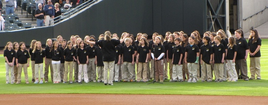 Kids singing the National Anthem 4-27-10.JPG