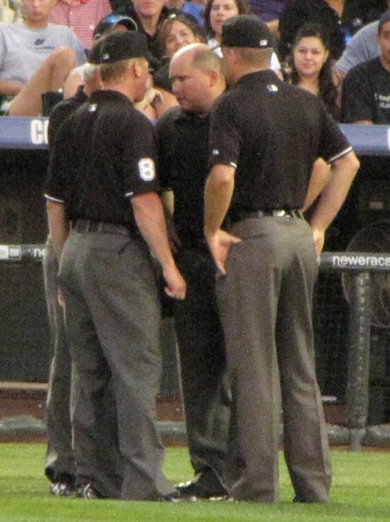 Umpires discussing 6-19-10.jpg