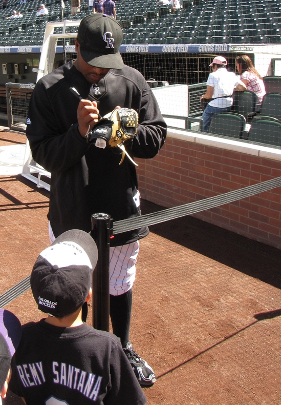 Chris Nelson signing a glove 9-12-10.jpg