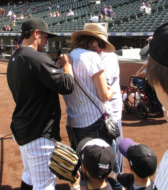 Michael McKenry signing a jersey 9-12-10.jpg